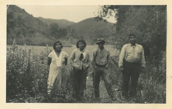 An archival photo from the early to mid-1930s of Allison Herrera's family near Toro Creek, an ancestral village of their Salinan Tribe. From left: Felista Rosas, her great-grandmother; Anna Herrera, her grandmother; Andy Rosas, Anna's brother; and Ramon Rosas, Andy and Anna's uncle.