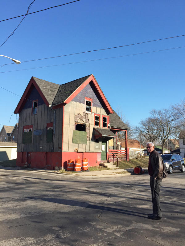 Heiner Giese, a local landlord and attorney for the Apartment Association of Southeastern Wisconsin, stands in front of a city-owned abandoned building.
