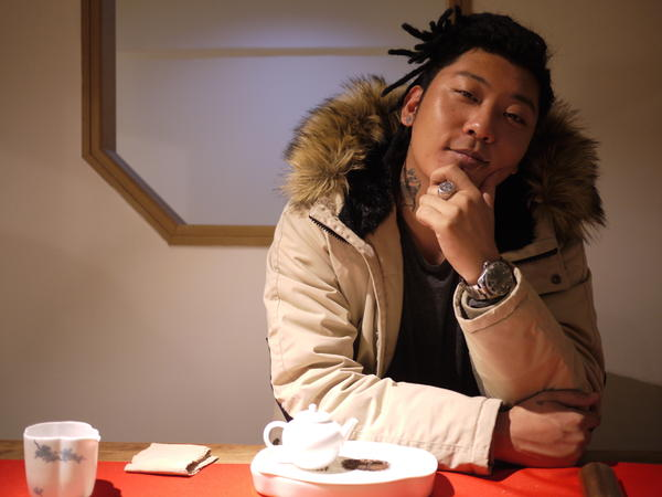 Rapper Kafe Hu sits in his neighborhood teahouse in Chengdu. The 30-year-old says the city's laid-back culture is one of the reasons the metropolis of 14 million people has become the epicenter for Chinese rap music.
