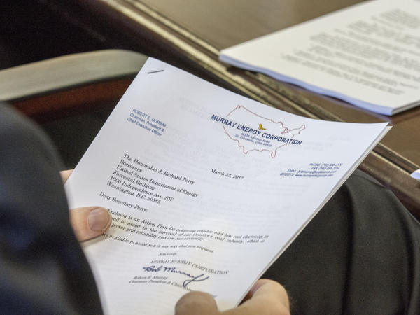"A photo obtained by The Associated Press shows the cover sheet of a confidential ""action plan"" brought by Robert Murray, of Murray Energy, to a meeting at the Department of Energy headquarters in Washington, D.C."