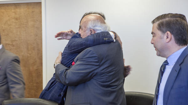 Another photo obtained by The Associated Press shows Robert Murray (right) hugging Perry at the Department of Energy headquarters.