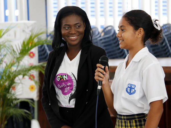 Jubilante Cutting, left, the founder of Guyana Animation Network, stands with a student from Marian Academy in Georgetown, Guyana. Last year, Cutting launched a project to help high school girls explore careers in digital media and animation.