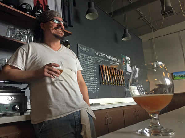Thomas Croskrey, head brewer at Bellwether Brewing Company in Spokane, will tap a keg of his plum beer on anuary 25. The plums he used in the beer he made came from the Spokane Edible Tree Project, a non-profit that aims to keep food from going to waste.