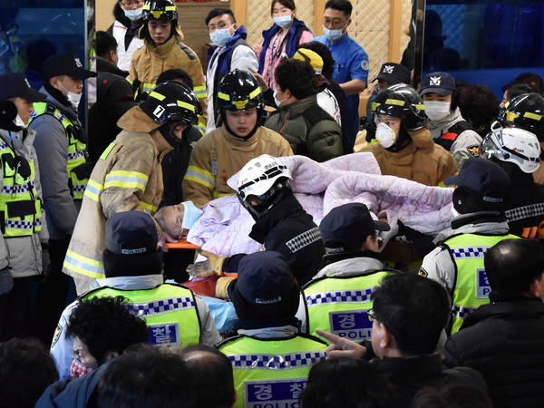 Rescue workers remove a survivor from a hospital fire on Friday in Miryang, South Korea.