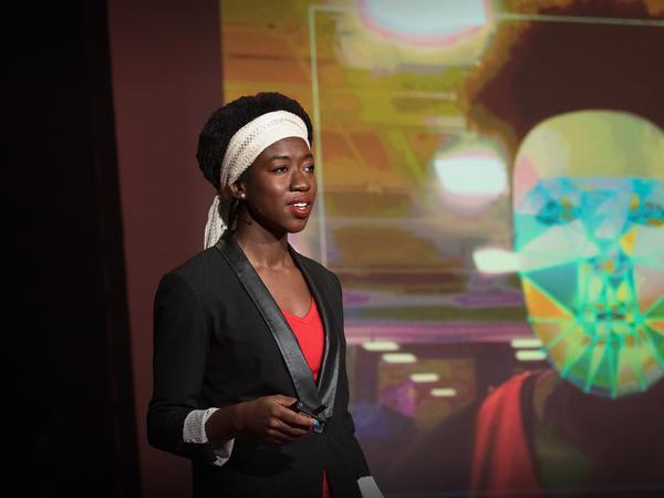 Joy Buolamwini on the TED stage.