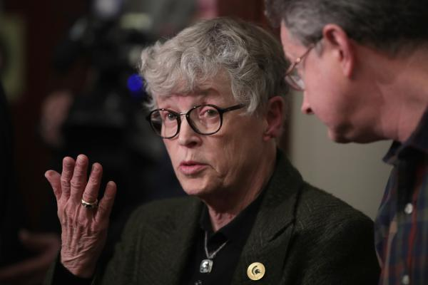 Michigan State University President Lou Anna Simon answers a question after being confronted by former MSU gymnast Lindsey Lemke during a break in the sentencing hearing for Larry Nassar. Nassar was sentenced to 40 to 175 years in prison this week for sex crimes.