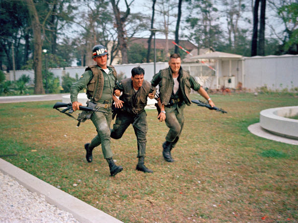 Two U.S. military policemen aid a wounded fellow MP during fighting in the U.S. Embassy compound in Saigon, at the beginning of the Tet Offensive. A Viet Cong suicide squad seized control of part of the compound and held it for about six hours before being killed or captured.