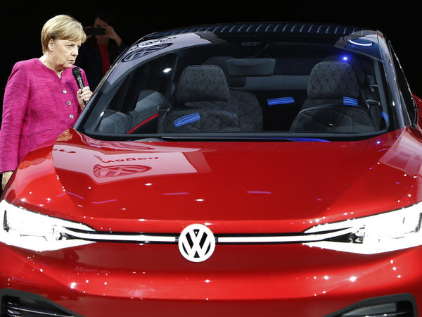 German Chancellor Angela Merkel at the 2017 Frankfurt Auto Show. Revelations about emissions experiments on humans and monkeys, paid for by German automakers, have drawn global outrage from politicians, animal rights activists and environmentalists.