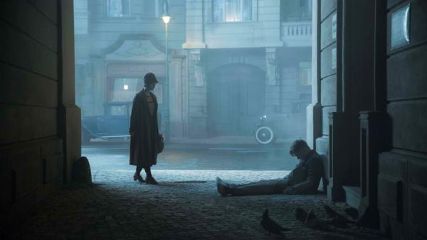 Lotte finds police inspector Gereon Rath (Volker Bruch) in a Berlin doorway after a rough night in <em>Babylon Berlin</em>.