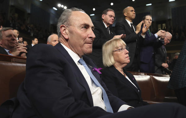 Democratic Sens. Chuck Schumer of New York and Patty Murray of Washington state listen to the president's address.