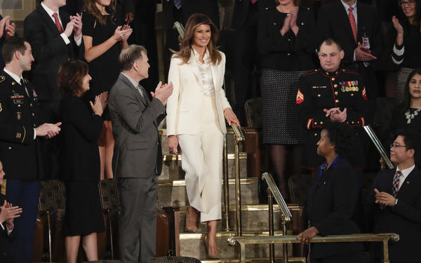 First lady Melania Trump's all-white outfit had many wondering: What message is she sending?