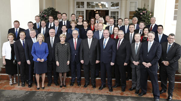 Australian Prime Minister Malcolm Turnbull's government is looking into how hundreds of secret documents were left inside two large cabinets that were sold. He's seen here with members of his Cabinet after they were sworn in in 2016.