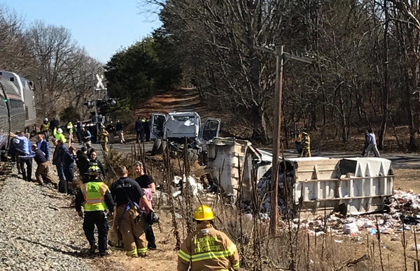 A chartered train carrying dozens of GOP lawmakers to a Republican retreat in West Virginia struck a garbage truck near Charlottesville, Va., on Wednesday, lawmakers said. This photo provided by Rep. Greg Walden, R-Ore., shows the crash site on Wednesday.
