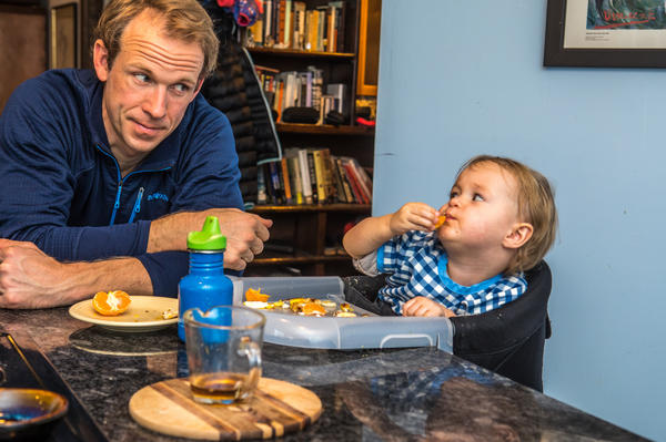 Lowell Bailey eats with daughter Ophelia at home. She and Bailey's wife, Erika, travel with Bailey on the World Cup circuit. At last year's World Championships, Erika ran and cheered alongside the final stretch with Ophelia, then 8 months old, strapped to her chest.