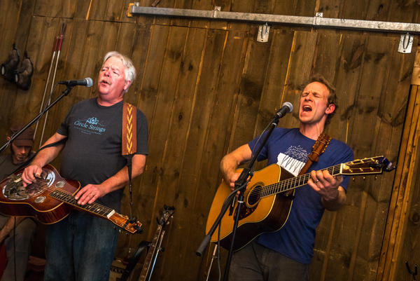 Lowell Bailey (right) performs with John Doan in the local band Big Slyde at Cascade Ski Touring Center in Lake Placid.