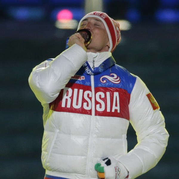 Russia's gold medal winner Alexander Legkov kisses his medal during the closing ceremony for the men's 50-kilometer cross-country race in Feb. 2014, in Sochi, Russia. Legkov is one of 28 athletes who have had their doping convictions overturned by a Swiss tribunal.