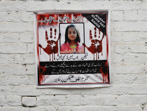 """A poster in Kasur, Pakistan, includes a picture of Zainab and the message: """"Protest. Protest. Protest. Daughter Zainab, we are ashamed. But if not now, then never. Zainab, in light of your martyrdom, we will seek accountability for all similar events in the past. We will not rest without that."""""""