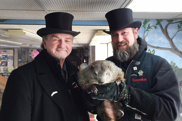 "John Griffiths and A.J. Dereume, members of Punxsutawney Phil's ""Inner Circle,"" hold the famous groundhog."