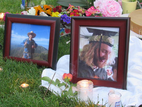 Mourners lit candles and incense and laid flowers before photos of Taliesin Myrddin Namkai-Meche of Ashland. Namkai-Meche died Friday while trying to defend some young women on a train in Portland.