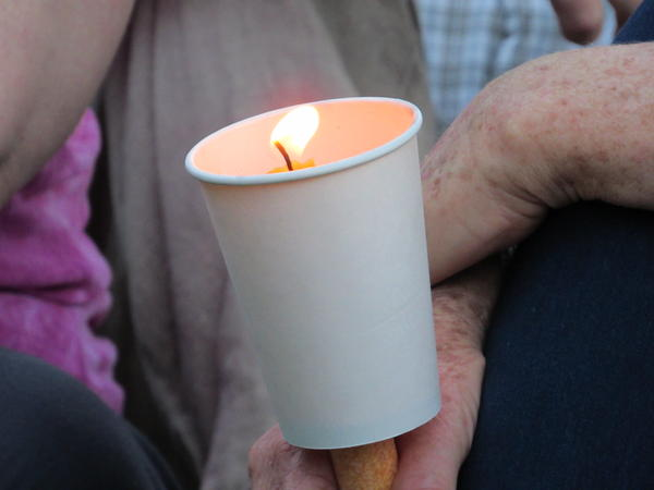 Community members held candles in memory of Taliesin Namkai-Meche in Lithia Park Saturday evening, May 27.