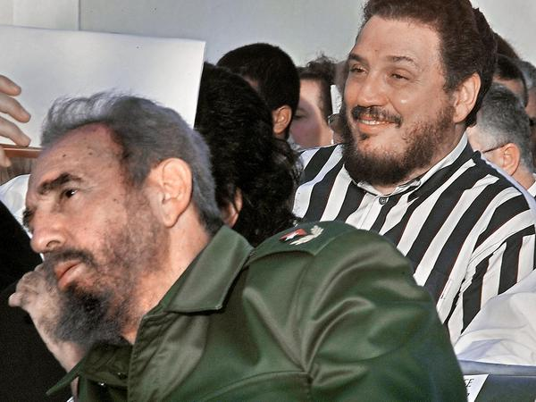 A photo from 2002 shows Fidel Castro Díaz-Balart (right), with his father, Cuban leader Fidel Castro during the Havana Book Fair opening.