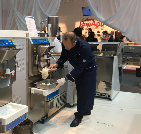 Gianpaolo Valli makes a batch of no-sugar-added hazelnut gelato using one of the new machines, which makes necessary adjustments to keep the small ice crystals that give gelato its signature structure.