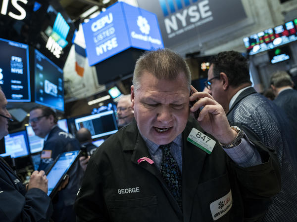 Traders at the New York Stock Exchange on Friday. The Dow Jones industrial average fell 666 points amid signs that interest rates are heading higher.