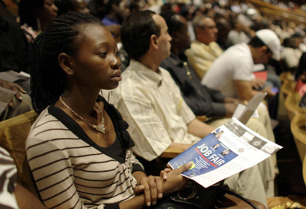 People in Miami, Fla., attend a 2011 job fair sponsored by the NAACP meant to lower the high rate of unemployment in the black community.