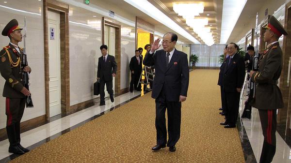 North Korean Chairman of the Presidium of the Supreme People's Assembly Kim Yong Nam, center, walks through the Pyongyang International Airport, in 2015, in Pyongyang, North Korea.