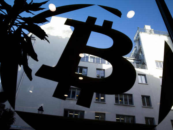 A Bitcoin logo on a window at La Maison du Bitcoin in Paris in a photo from January