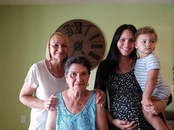 From left to right: Ana Gonzalez, Josefa David, Nicole Reyes and her 1.5-year-old son