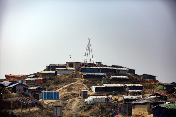 The rigging to drill a new water well tops a hill in the Kutupalong camp.