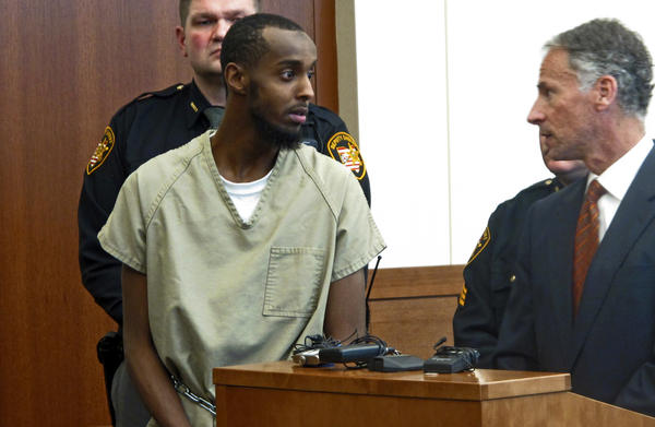 Abdirahman Sheik Mohamud is shown in a Columbus, Ohio, courtroom in 2015. He was arrested after traveling to Syria, then returning to Ohio, where he planned to carry out an attack. According to a new report, he's one of 12 Americans who went to join extremist groups in Syria or Iraq, and then returned back to the U.S. Mohamud was sentenced last month to 22 years in prison.