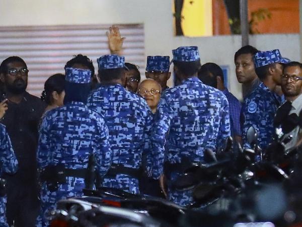 Policemen arrest former Maldives president and opposition leader Maumoon Abdul Gayoom.