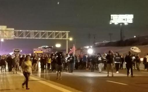 Protesters block eastbound lanes of I-64 at Jefferson in the city of St. Louis on Oct. 3, 2017.