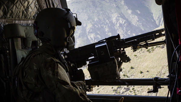A U.S. Army helicopter crew chief scans the ground near Mazar-e-Sharif, Afghanistan in June 2017.