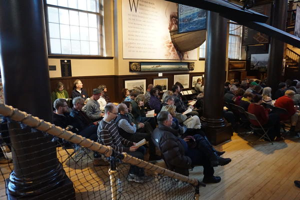 Visitors listen to Moby Dick read aloud, during the annual Moby Dick Marathon at the New Bedford Whaling Museum.