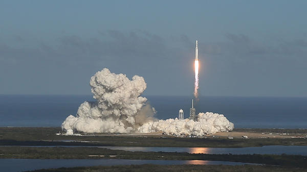 Falcon Heavy blasts off Launch Pad 39A at the Kennedy Space Center on Tuesday.
