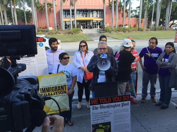 South Florida immigration activists protest last week in front of the Miami-Dade County Auditorium, where Mayor Carlos Gimenez was about to give his State of the County address.