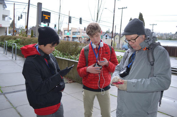 <p>After their walk, John Hoac, Brandon Teeny, and Troy Abel take stock of the pollution they mapped on their walk around campus.</p>