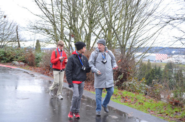 <p>Two Cleveland High School students, Brandon Teeny and John Hoac, and Western Washington University Professor Troy Abel are measuring pollution on the Cleveland campus in south Seattle.</p>
