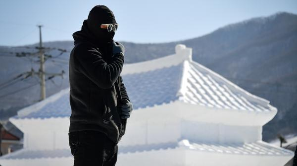 The Pyeongchang 2018 Winter Olympics reverse a recent trend of relatively warm conditions at the Winter Games. Here, a man prepares to work in front of an ice sculpture ahead of Friday's opening ceremony.