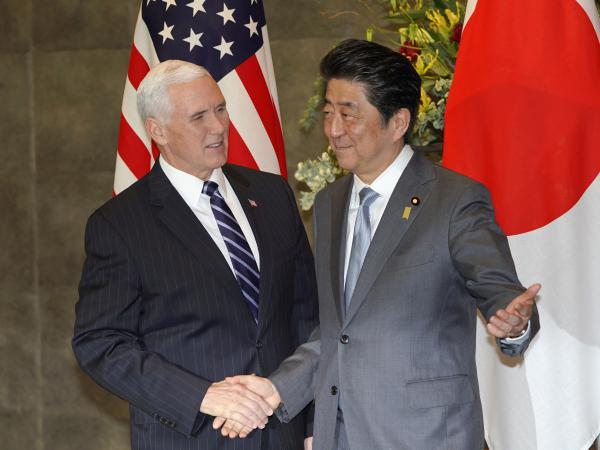 Vice President Pence is greeted by Japanese Prime Minister Shinzo Abe prior to a meeting at Abe's official residence in Tokyo on Wednesday.