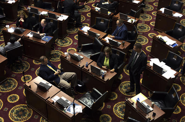 Members of the House talk with each other on the last of the 2017 legislative session.