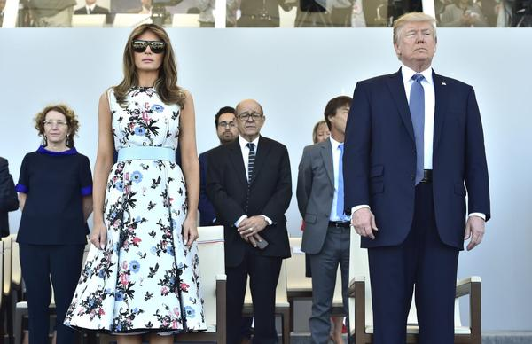 First lady Melania Trump and President Trump attend the annual Bastille Day military parade on the Champs-Elysees avenue in Paris, Friday, July 14, 2017. (Christophe Archambault, Pool via AP)