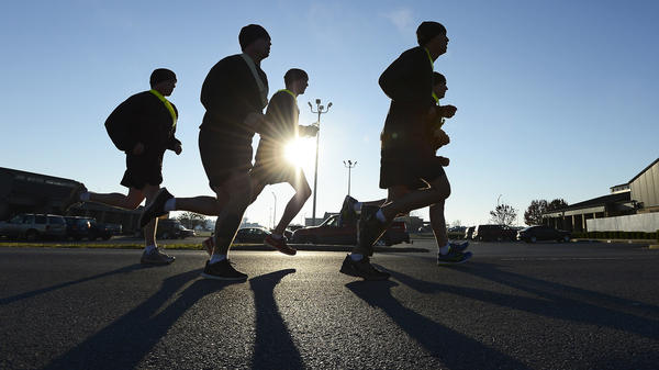 Members of the Pathfinders 5th Battalion, 101st Combat Aviation Brigade of the 101st Airborne Division, go for a run at Fort Campbell, Ky., in 2013. The Census Bureau says it will count deployed service members as residents of their home bases or ports for the 2020 census.