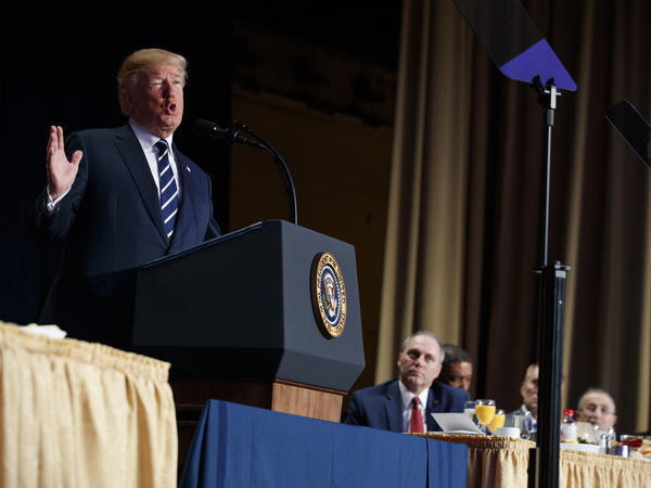 President Trump speaks during the National Prayer Breakfast in Washington, D.C., as Rep. Steve Scalise, R-La., watches.
