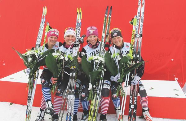 US Ski Team members pose in their striped relay socks celebrating their first-ever podium finish in a World Cup relay race in Gallivare, Sweden in November, 2012. (Left-to-right: Jessie Diggins, Holly Brooks, Kikkan Randall and Liz Stephen.)