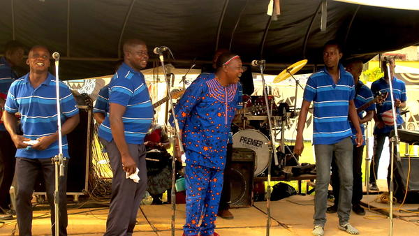 Ambassador Osayomore Joseph, center, and his band performing at a wedding ceremony in Benin City, Nigeria on December 31, 2016.