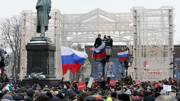 Protesters fly Russian flags during a Jan. 28 rally at Pushkin Square in Moscow, in opposition to authorities' decision to reject Navalny's presidential candidacy.